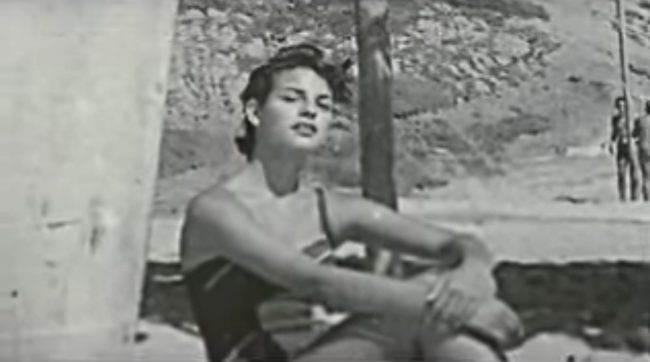 Unknown at the time the lovely Raquel-Welch seeks shade underneath the Windansea Shack